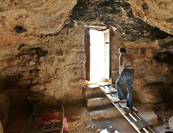 An entrance to the cave underneath St. George\'s Church in Rihab, Jordan