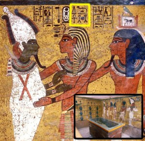 "King Tut's Burial Chamber - Osiris embracing Tutankhamun, ""Giving all life for time and eternity."" The ankh, neheh, and djet symbols are highlighted in yellow."