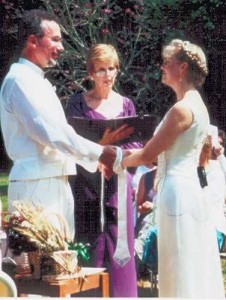 A typical wedding ceremony with handfasting, consisting of tying the hands of the bride and groom together.