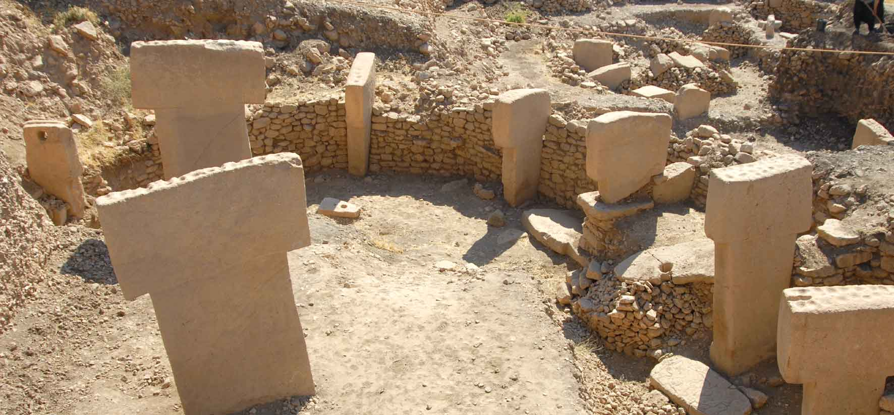 One of the excavated enclosures at Göbekli Tepe, Turkey, with massive T-shaped megaliths forming ancient stone circles thought to be up to 12,000 years old. (Click for a larger view)