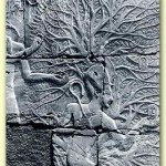 The god Osiris paints Pharaoh's name onto leaf of the tree of life. Karnak. (click for larger view)