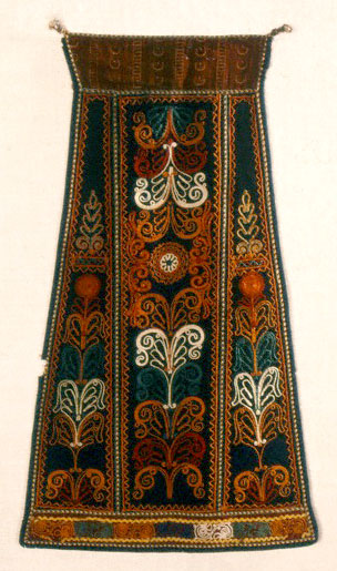 Apron, 19th century Karagouna, Thessaly Athens, Museum of Greek Folk Art, Inv. No. 6633. The Karagounides were indigenous Greek inhabitants of the Thessaly plain. This particular apron is trapezoidal... Its surface is decorated all over with motifs including honeysuckle, spirals, arabesques and rosettes, and would appear to be a bridal apron judging from the lavish ornamentation.