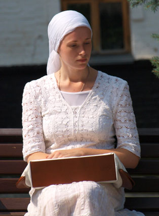 Eastern Orthodox Christian pilgrim at Kiev Monastery of the Caves, Ukraine.  Women often cover their heads as prescribed by Paul.