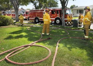 Pasadena Fire Department and local gardeners respond to a house fire