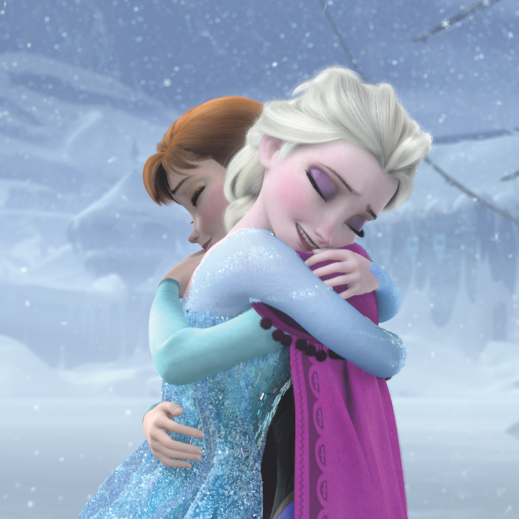 Anna and Elsa embrace at the end of Frozen.